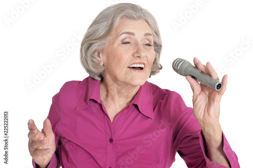 Photographie  Portrait of senior singer woman on white background
