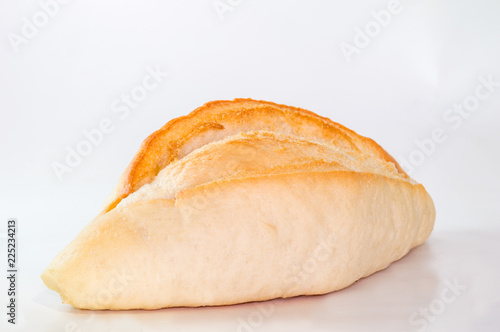 Fresh baked bread. Isolated on white. Room for text