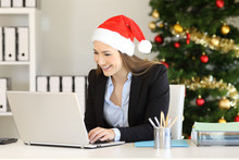 Office Worker Working With A Laptop In Christmas
