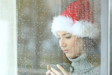 Sad Woman In Christmas In A Ra...
