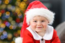 Happy Kid Looking At Camera In Christmas