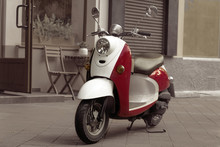 Vintage Scooter Stands In An A...