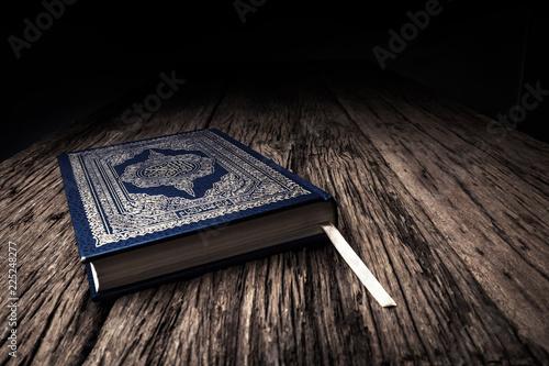 Fototapeta Koran - holy book of Muslims ( public item of all muslims ) on the table , still