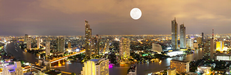 Fototapeta Panorama Miasta Panorama view Bangkok city and river with moon in night Cityscape Thailand