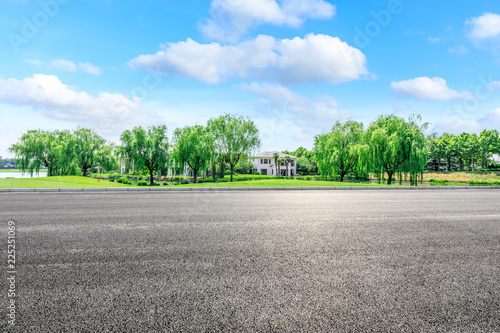Poster Blauw Asphalt highway and green forest natural scenery under the blue sky