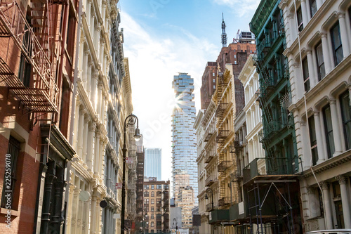 Deurstickers New York City View of the historic buildings at the intersection of Greene and Canal Streets in SoHo Manhattan, New York City with sunlight shining in the background