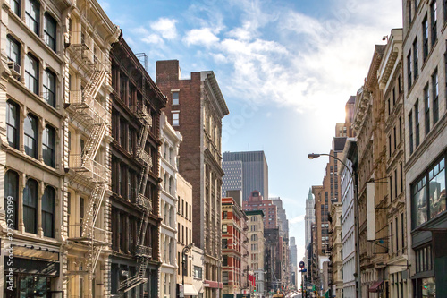 Foto op Plexiglas New York City Sunlight shines on the buildings along Broadway in SoHo, New York City