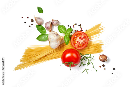 Spaghetti pasta with tomatoes garlic and basil isolated on white background. Top view.