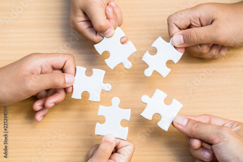 Fototapety, obrazy: Hands of diverse people assembling jigsaw puzzle, Youth team put pieces together searching for right match, help support in teamwork to find common solution concept, top close up view