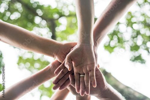 Fotomural  Close up team students teamwork stack hands together
