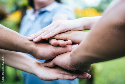 Pinturas sobre lienzo  Close up team students teamwork stack hands together