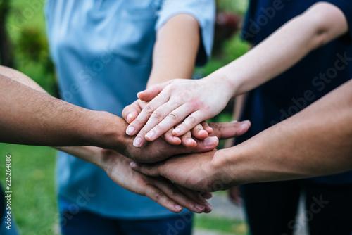 Fotografía  Close up team students teamwork stack hands together