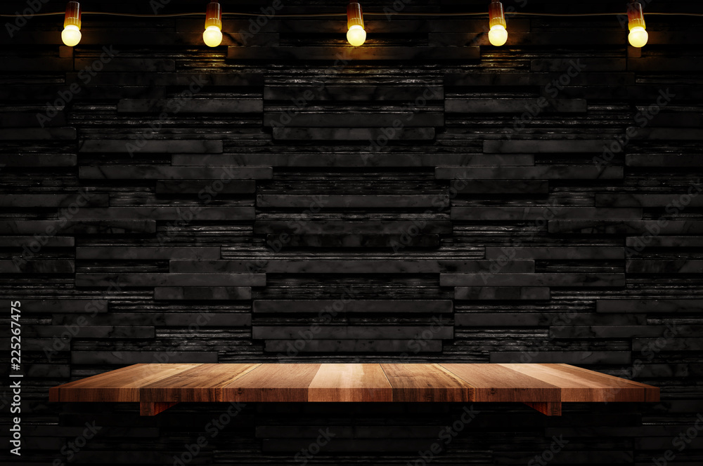 Fototapeta Empty brown plank wood shelf at black layer marble tile wall background,Mock up for display or montage of product or design