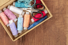 Overhead Photo Of Sewing Box With Threads, Needles, Scissors, And Copy Space