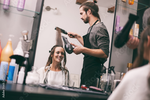 Young Woman Getting New Hairstyle At Professional Hair Styling
