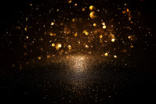 Glitter Vintage Lights Background. Black And Gold. De-focused.