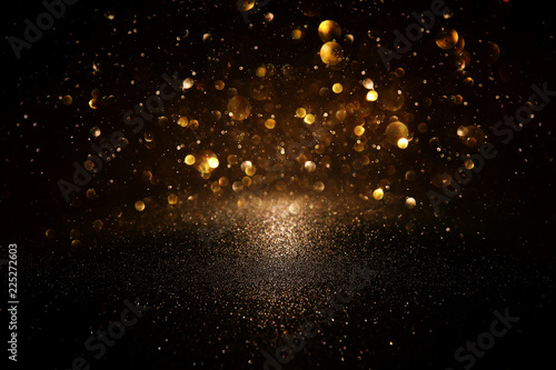 Fotografie, Obraz  glitter vintage lights background. black and gold. de-focused.