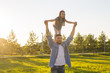 Fatherhood, family and children concept - Father and daughter having fun and playing in nature.