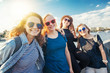 Group of happy smiling carefree young stylish girl female friends on city background, millennials concept, youth and students, travel and vacations tpgether