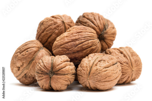 Pile of organic walnuts isolated on white background