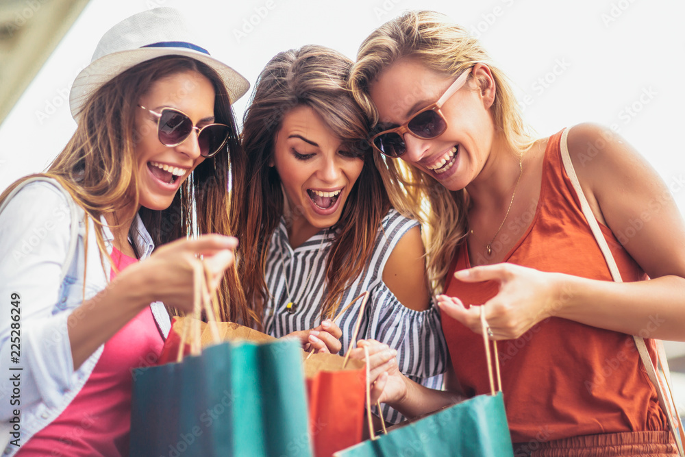 Fototapeta Beautiful woman with shopping bags in the city-sale, shopping, tourism and happy people concept