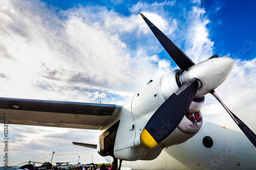 Fényképezés  airplane wing with a propeller against the sky, close-up photo, air travel conce