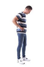 Side View Of Young Disappointed Sad Man Looking Down With Hands On Hips. Full Body Isolated On White Background.