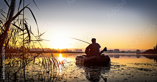 Printed kitchen splashbacks Fishing Fishing. Sunset on the lake.