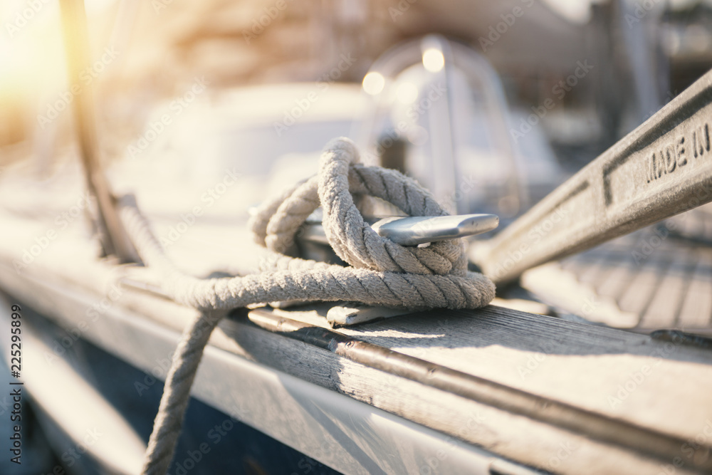 Fototapeta Mooring rope and bollard at the harbor
