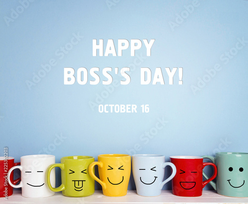 Fotografiet Boss day background with colorful mugs.