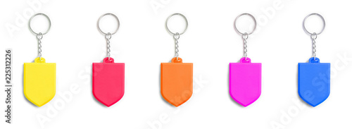 Photo colorful key chain trinkets in a row