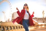 Fototapeta Londyn - Beautiful woman doing shopping in London