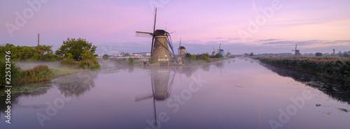 Early morning mist on an autumn morning in the Kinderdijk UNESCO Heritage centre of windmills near Rottterdam, Netherlands