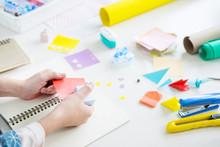 Woman's Hand Cut Paper Making A Scrap Booking Or Other Festive Decorations DIY Accessories Arrangement.