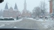 Crossroad in Lubeck city in winter time. View inside the car, wet car glass