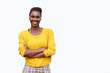 happy african american woman with arms crossed against isolated white background