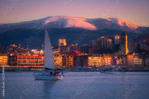 Foto op Plexiglas Oranje Getxo village with a sailboat in winter
