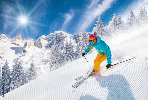 Fotobehang Wintersporten Skier skiing downhill in high mountains