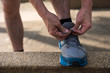 Male athlete Runner tying running shoes
