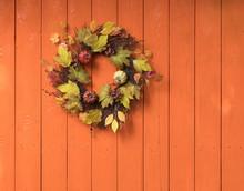 Autumn Halloween Wreath On Orange Wooden Background