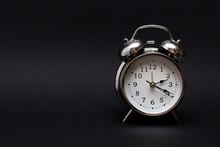 Black Retro Alarm Clock In Dark Background.For Time Concept.