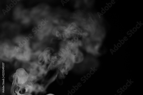 Fotobehang Rook White smoke on a black background. Texture of smoke. Clubs of wh