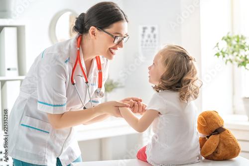 Fotografering  Doctor examining a child