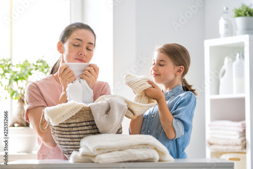фотография family doing laundry at home