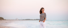 Stylish Woman On Beach In Even...