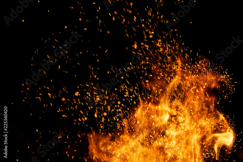 obraz lub plakat Fire sparks with flames on black background