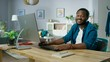 """Includes Audio: Handsome Successful Man Uses Personal Computer at Home Looks at Camera and Says with a Smile: """"Hello, My Name is John and I Always Wanted to Start My Own Business""""."""