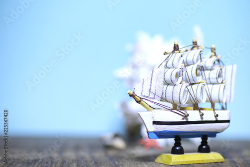 Foto op Aluminium Schip Old wooden ship with sails and masts toy on a stand. Vintage and