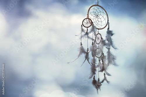 Foto Dream catcher on blue background with copy space