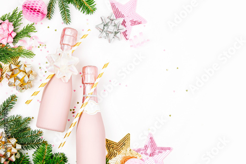 Pastel Pink confetti, champagne bottles and decorations Fototapeta